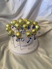 Red Velvet cake pops wrapped in gold paper